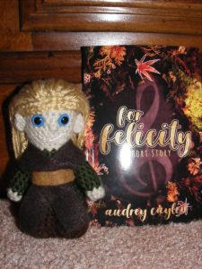 Glendale enjoying his copy of For Felicity by Audrey Caylin